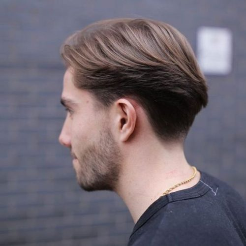 Men's Haircut Tucked Behind The